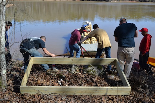 Workers prepare on January 20th to pour a concrete bulkhead for one of Retreat's new community docks coming in February.