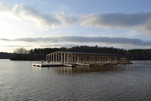 Retreat's newest dock is on the move crossing the lake en route to its new location off the shore of Retreat on West Point Lake.